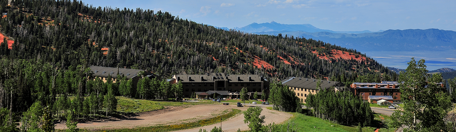 A view of Cedar Breaks Lodge & Spa surrounded by lush green trees