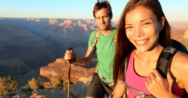 A couple hiking and enjoying the beautiful scenery that surrounds Cedar Breaks Lodge & Spa